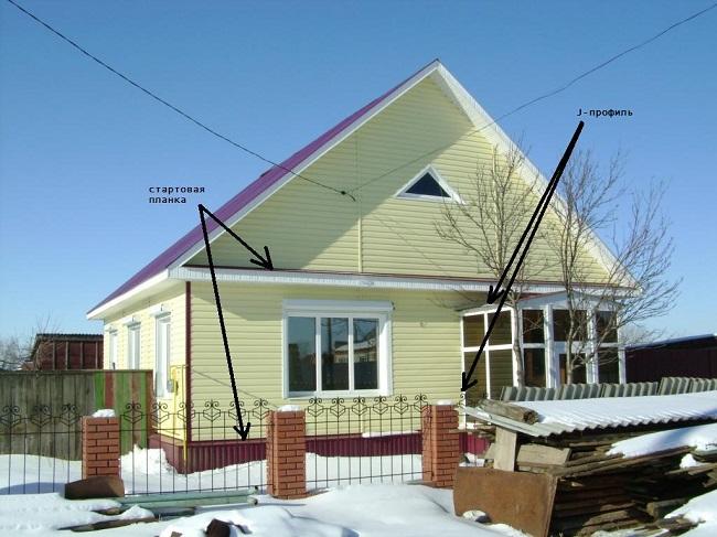 Кирпичный дом успешно обшитый сайдингом