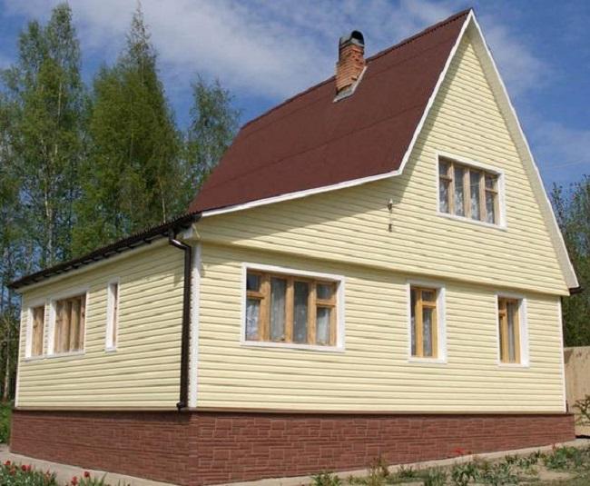Обшивка дома из панелей фальшбруса